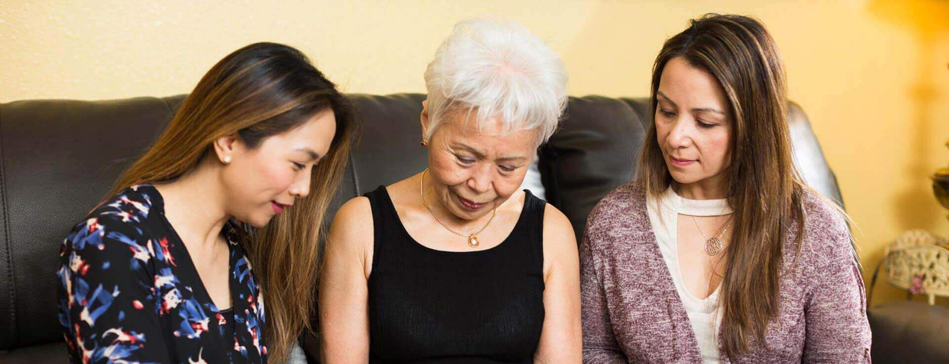 Elderly woman applying for home care with family member