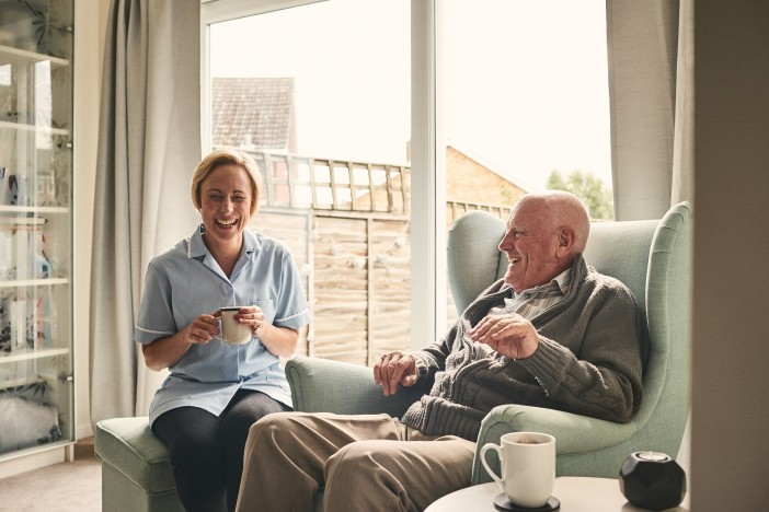 Caregiver Laughing With Older Man