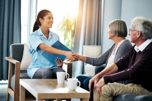 Caregiver Meets With Patient And Spouse