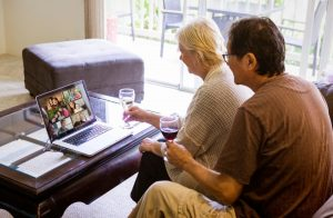 Couple Participating In Virtual Celebration With Family