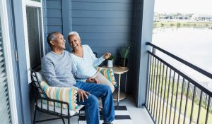 Couple Relaxing On Porch At Home